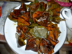 Banana leaf packets of highly seasoned minced chicken