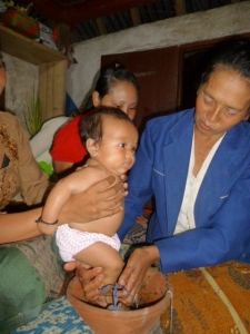 Nengah doesn't like baths, but she let granny administer this ritual cleansing
