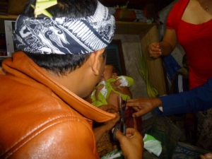 Cutting off the yarn bracelets