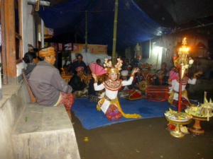 The firey torches in the center with offerings below, set the stage for the dancing