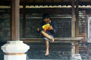 Balinese man reading the Festival Program