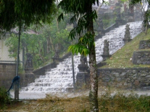 Rain making a waterfall down the temple steps