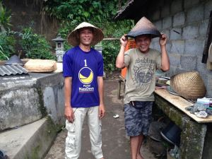 Ketut and Pasek's cousing with rice basket cookers on their heads